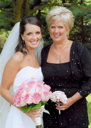 The Mother Of Bride Carried A Nose Consisting White And Pale Pink Spray Roses